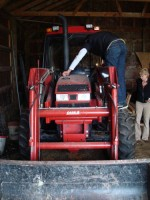 Dennis repairing the tractor