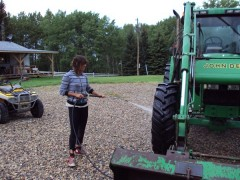 Anna is cleaning the tractor
